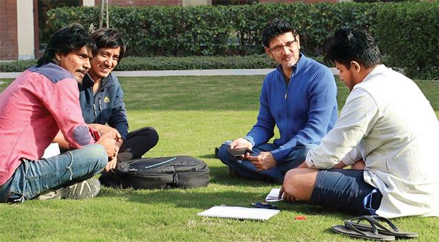Tushar Joag with his students.